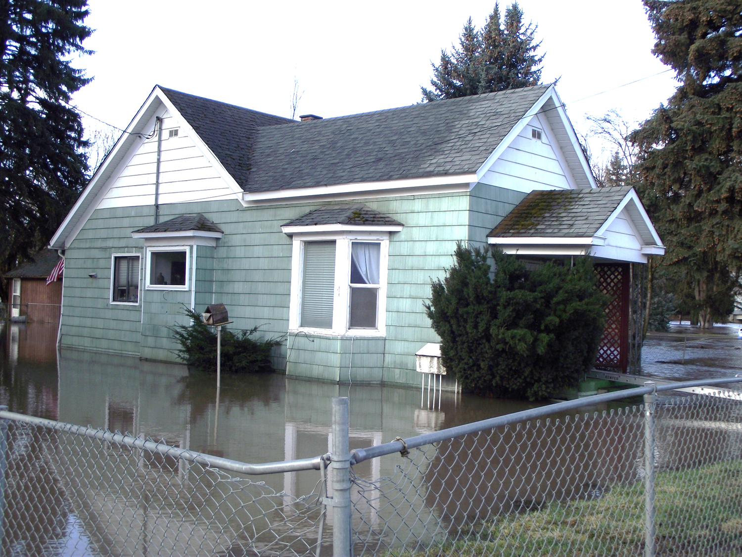 House Surrounded by Floodwaters